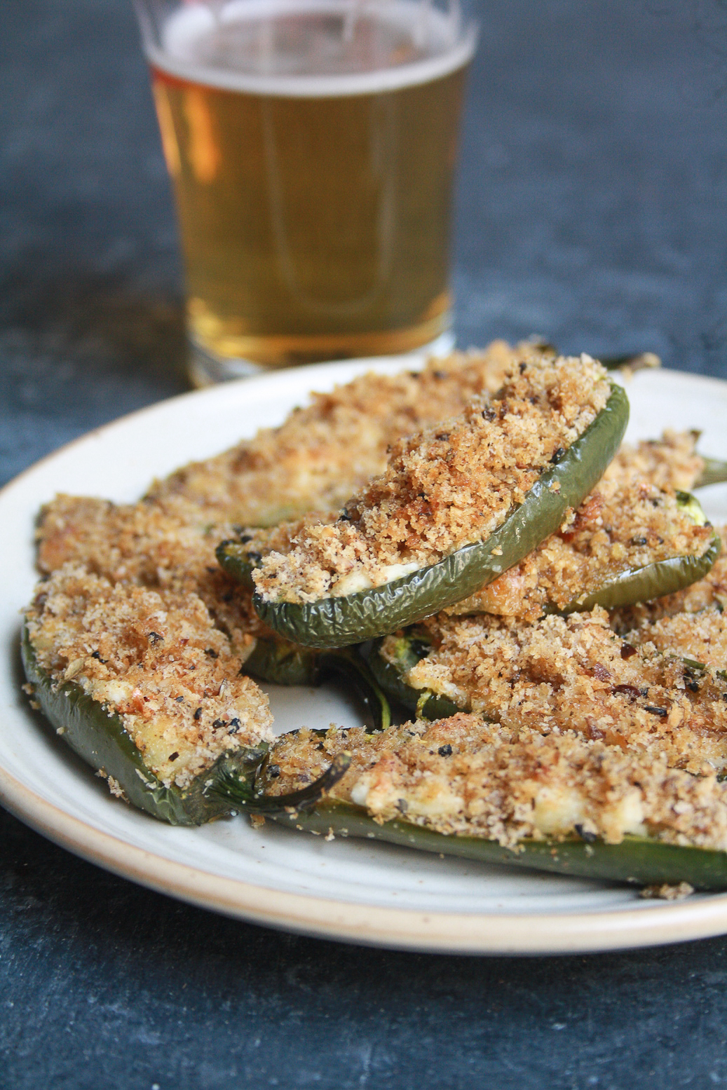Spicy baked jalapeño poppers with mozzarella cheese topped with crunchy breadcrumbs for a healthier snack!