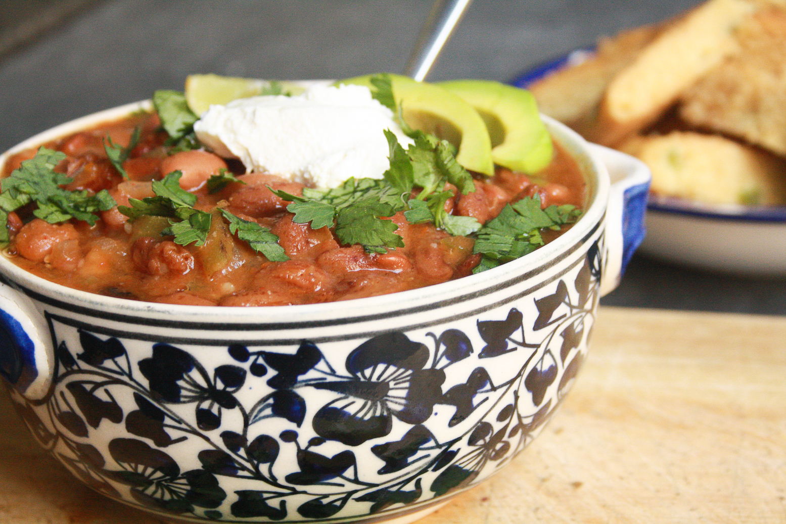 A hearty vegetarian chili with beans and veggies plus eggless, tender cornbread to go with it. Easily made vegan too!