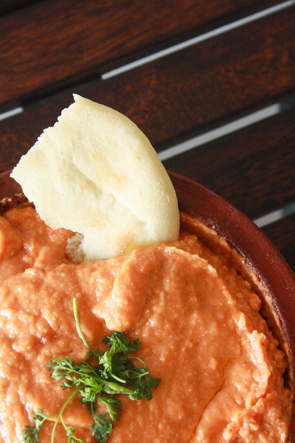 Classic hummus taken up a notch with juicy roasted peppers, served with soft and fluffy homemade pita!
