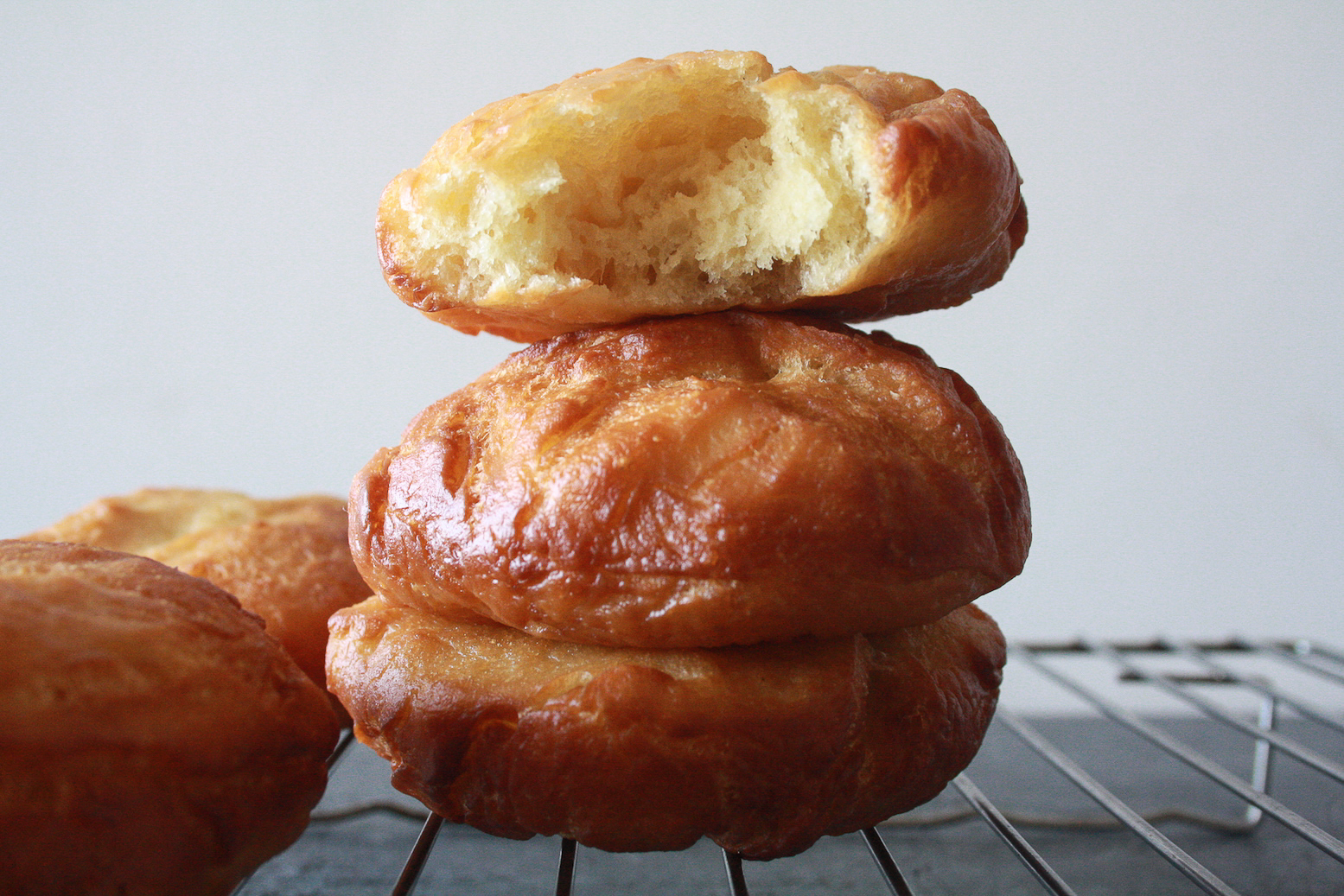 Soft, pillowy, buttery brioche donuts filled with fresh mango cream!