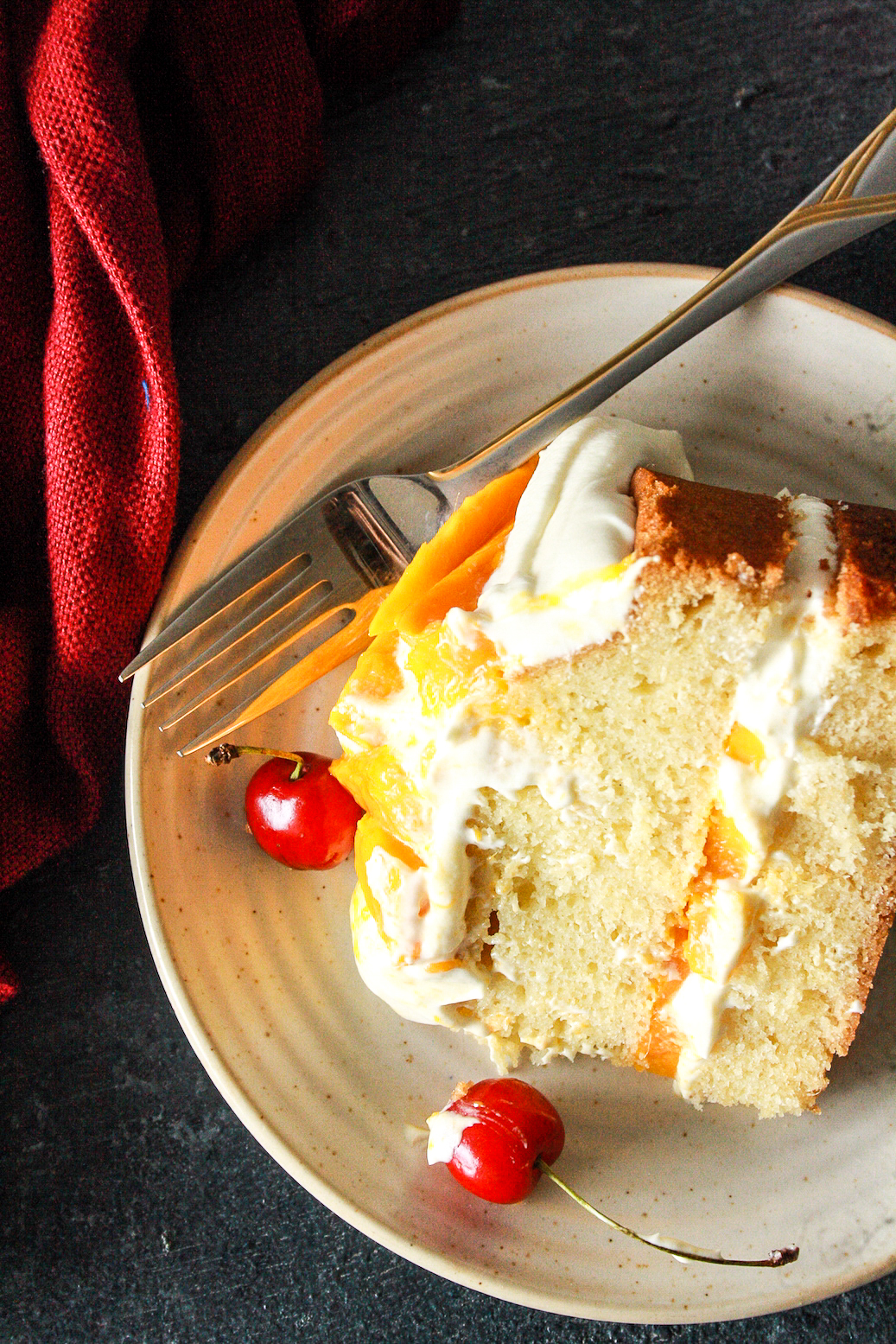 A classic, buttery, tender cake layered with tangy cream cheese frosting and lots of fresh mangoes!