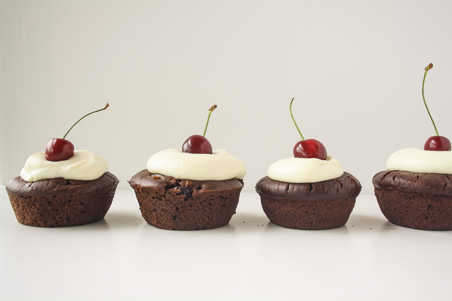 Rich, fudgy cakes filled with rum-soaked fresh cherries, served with a simple vanilla mascarpone topping!