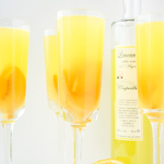A refreshing, citrusy sangria with fresh peaches and limoncello!