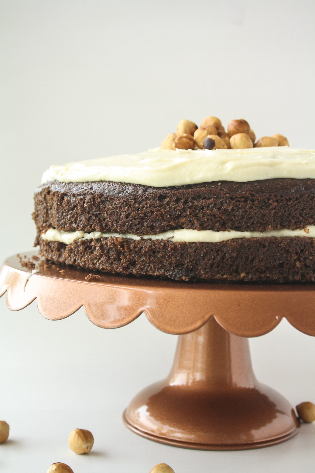 Moist chocolate cake filled with hazelnuts, layered with a hazelnut cream cheese frosting!