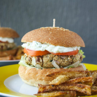 Hearty burgers with sweet potato, quinoa and kidney beans, topped with a light and creamy tzatziki