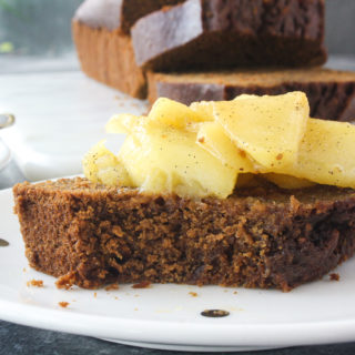 Moist, warmly spiced gingerbread cake with buttery apples cooked in whiskey!