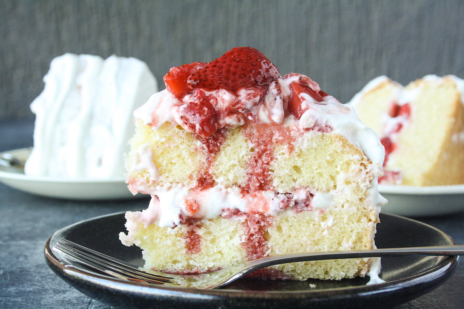 Tender butter cake layered with mascarpone cream frosting and juicy roasted strawberries!