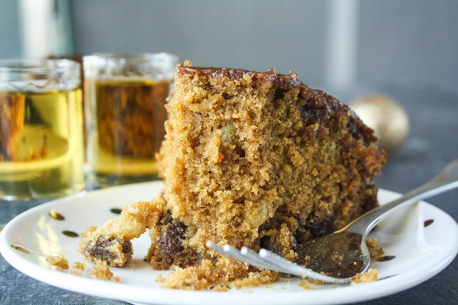 Moist and tender cake with whiskey-soaked raisins and a whiskey caramel glaze!