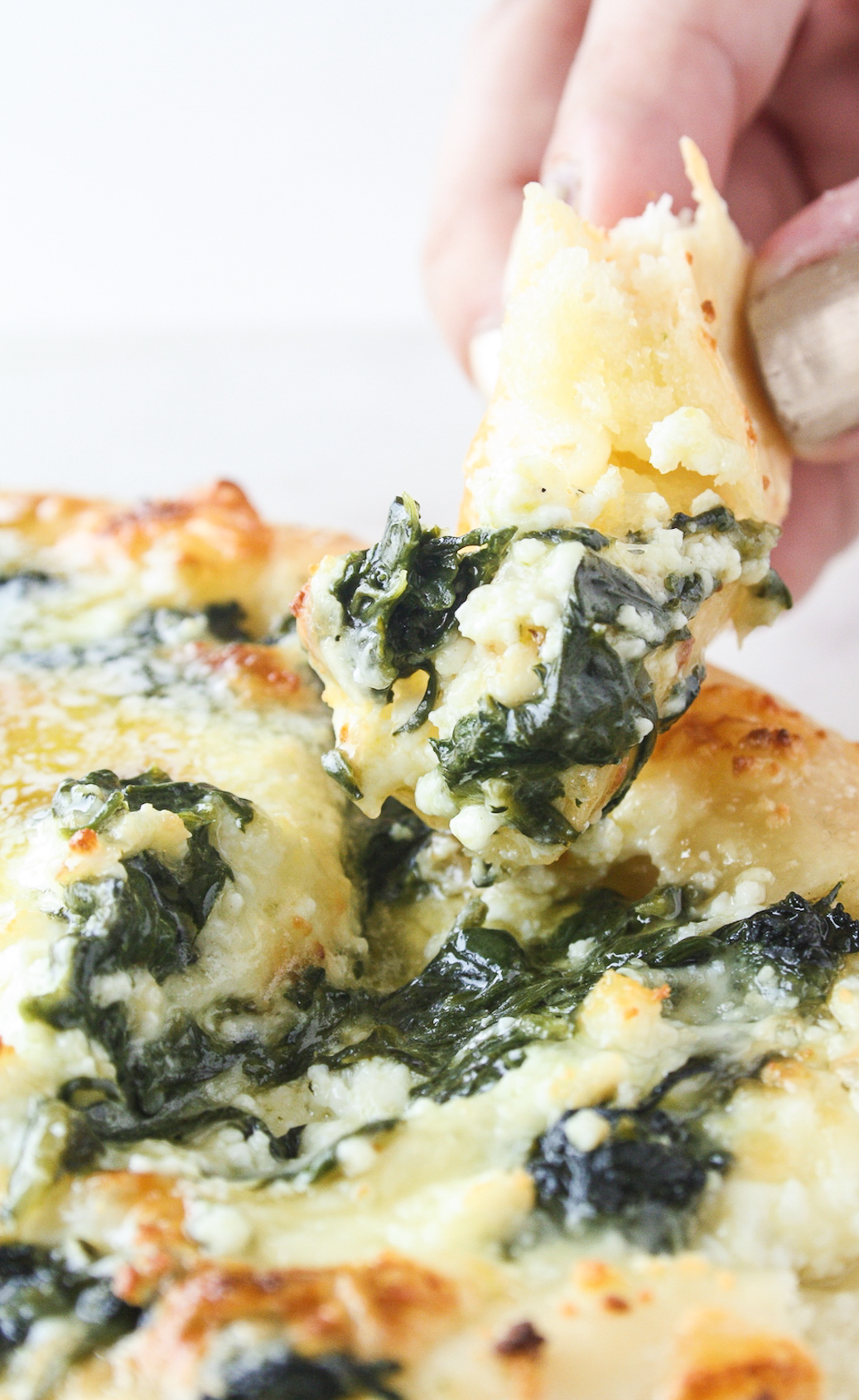 An eggless version of Khachapuri, a Georgian cheese-stuffed bread with spinach!