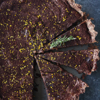 Rich chocolate tart infused with orange and rosemary, on a buttery flaky crust!