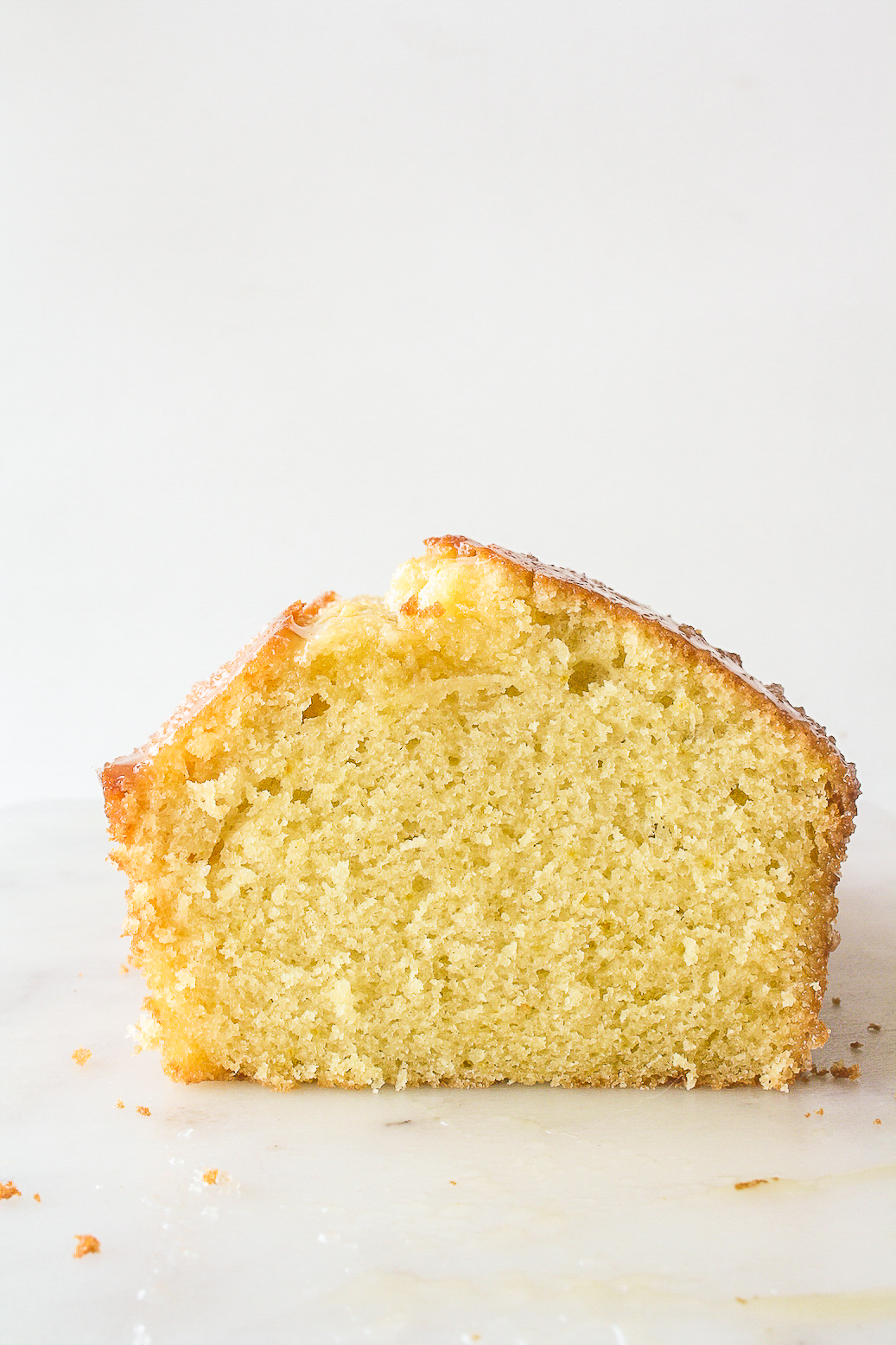 Moist, citrusy orange pound cake topped with a sticky whiskey glaze!