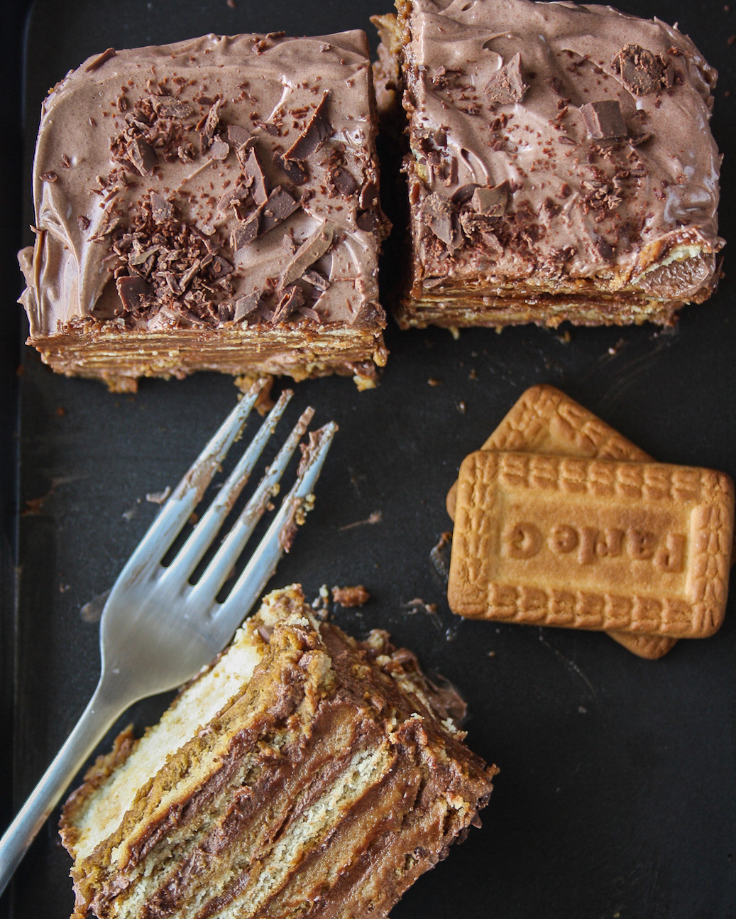 A decadent icebox cake with coffee-soaked glucose biscuits and silky chocolate frosting!