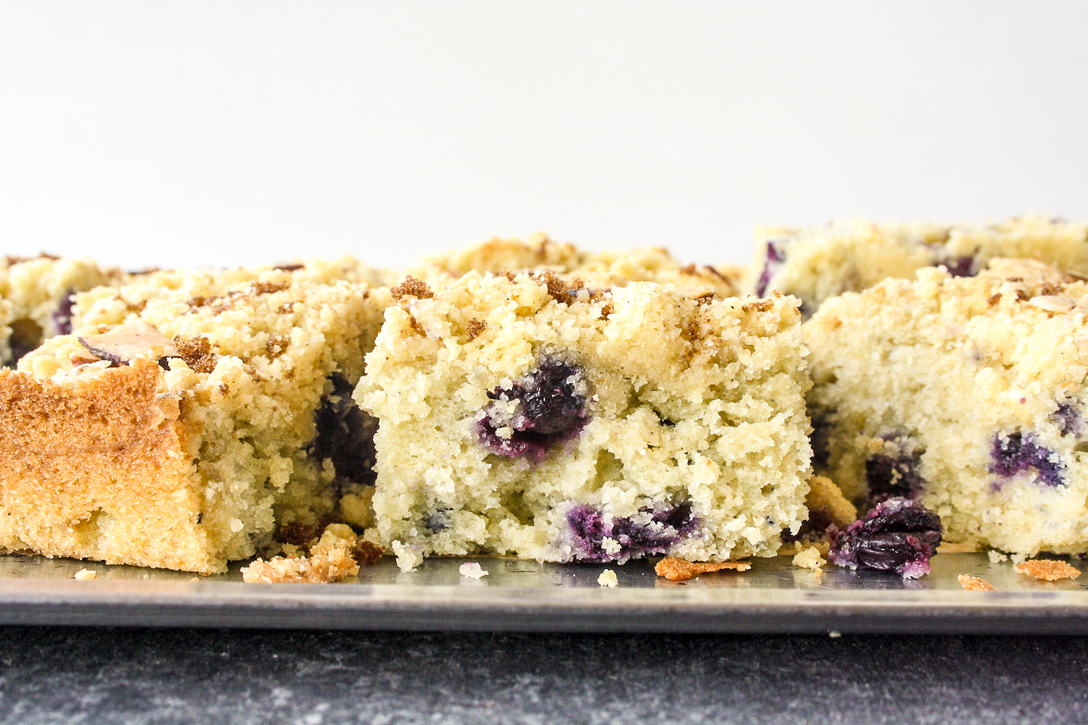A buttery, moist blueberry cake made with cornmeal and a crunchy streusel topping!