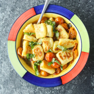 Pan-fried gnocchi in a delicious burst cherry tomato sauce!