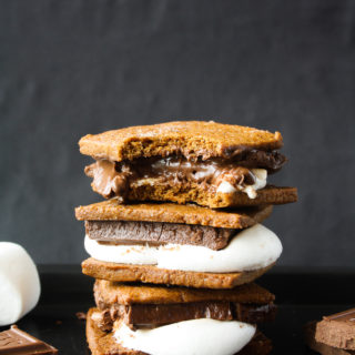 Delicious homemade graham cracker s'mores with melty chocolate and marshmallows!