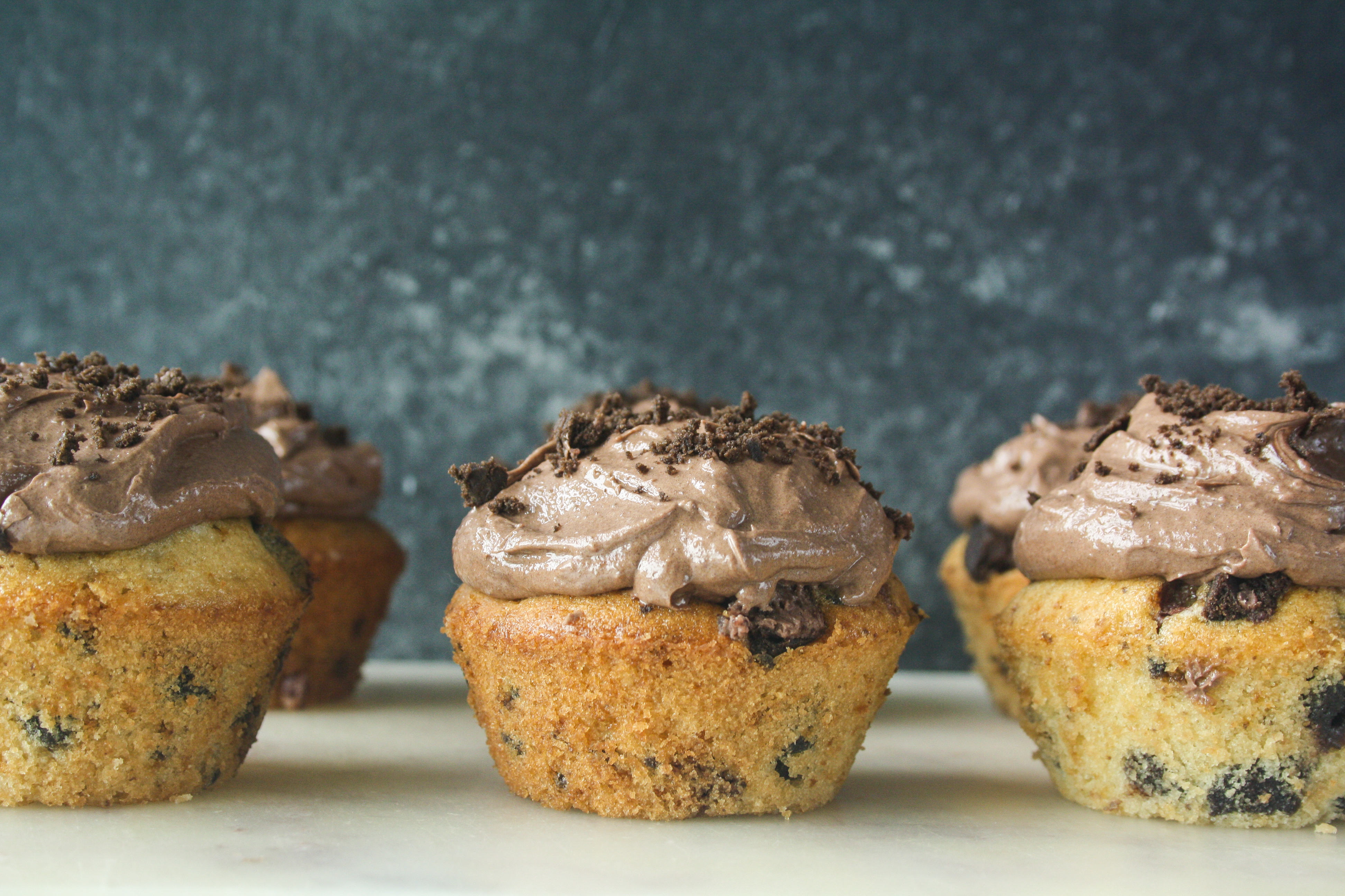 Soft, buttery cupcakes with bits of Oreos, and a creamy dark chocolate frosting!