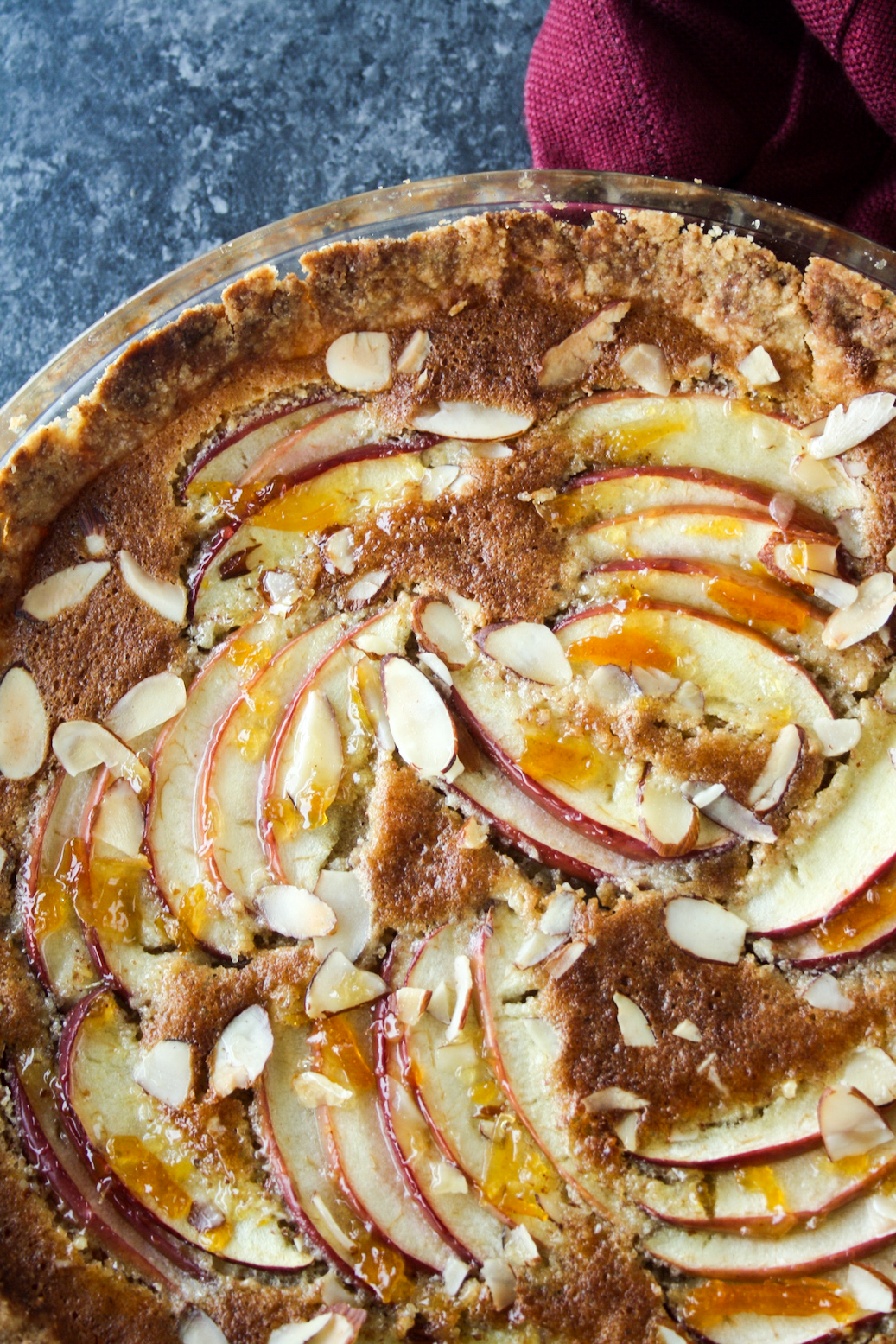 Almond frangipane tart with orange marmalade and sliced apples