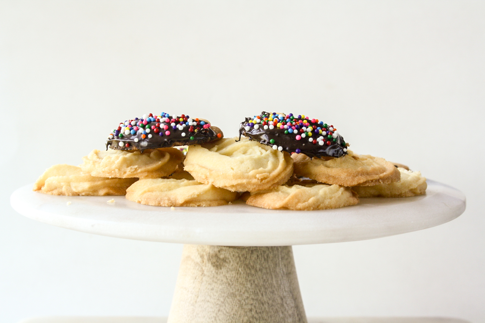 Crisp, buttery cookies dipped in melted chocolate and sprinkles