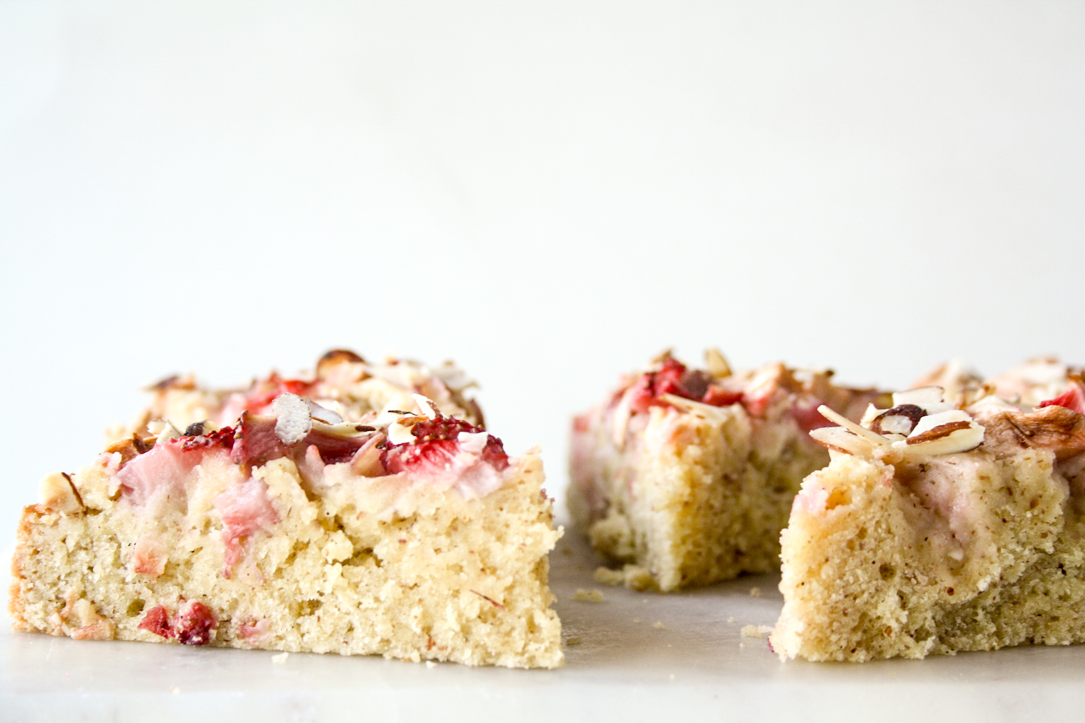 Tender almond and browned butter cake topped with fresh apples and strawberries
