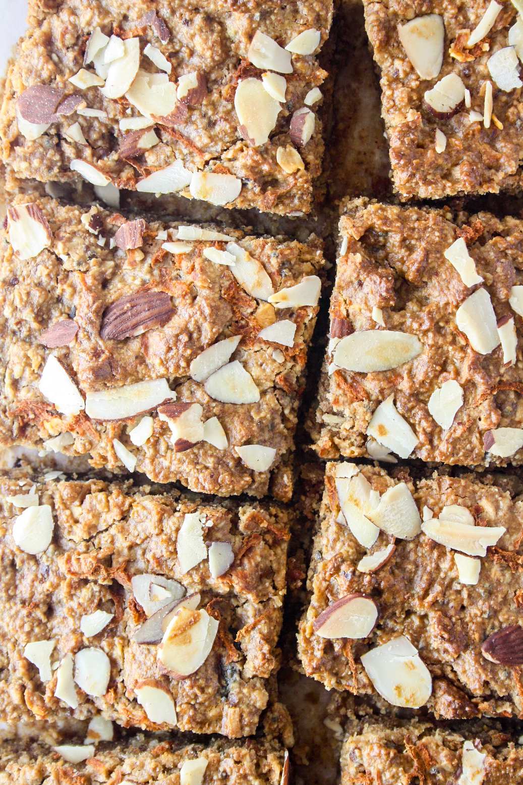 Soft and chewy healthy snack bars with almonds, oats and carrots