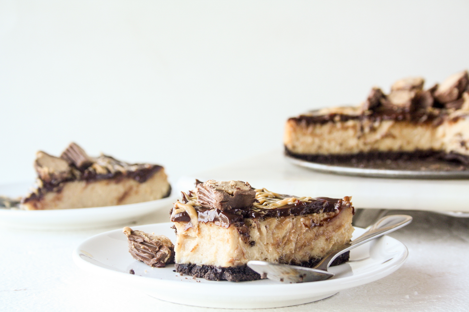 Creamy baked peanut butter cheesecake with Oreo crust and chocolate ganache
