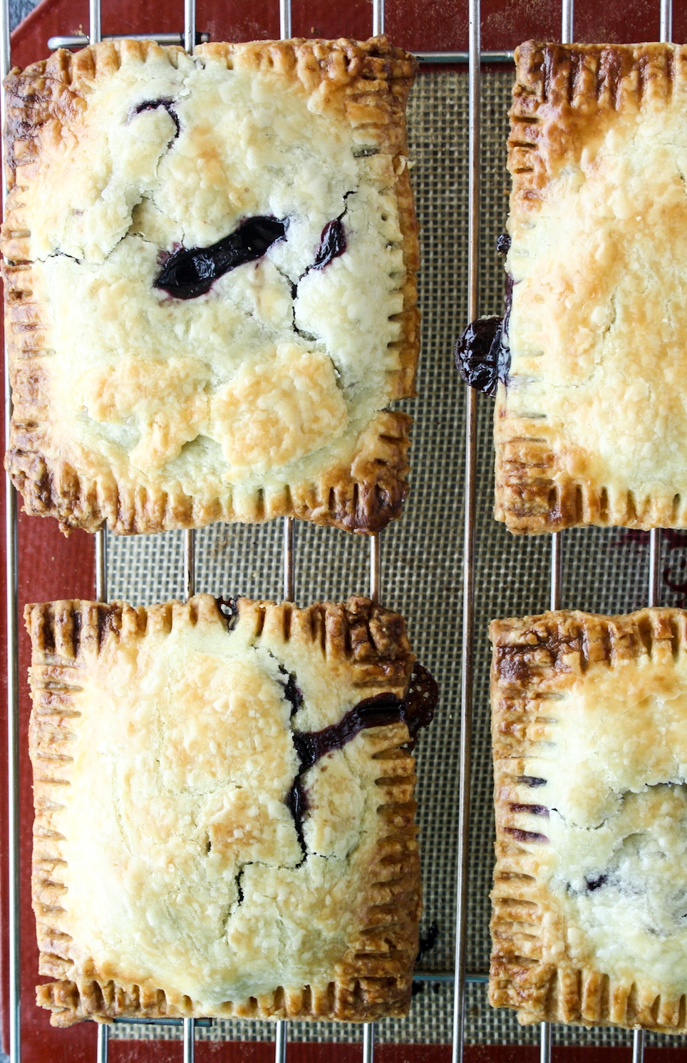 Buttery, flaky pop tarts with blueberry filling and tangy lemon glaze