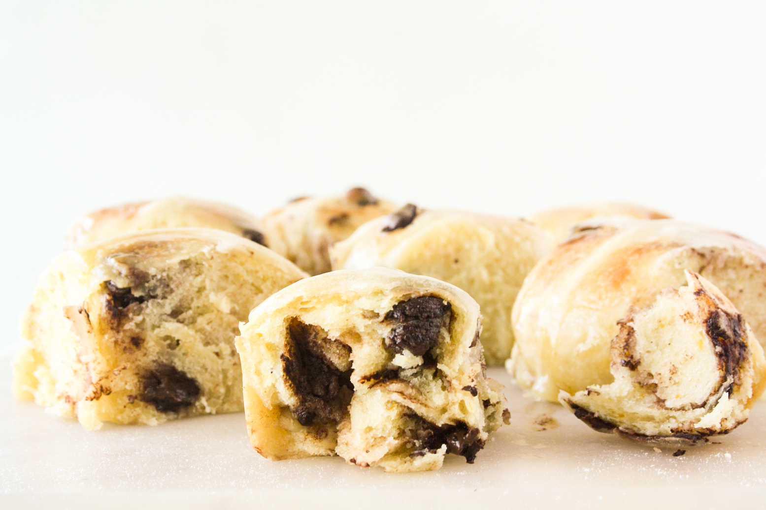 Soft and buttery hot cross buns with orange zest and chocolate chips