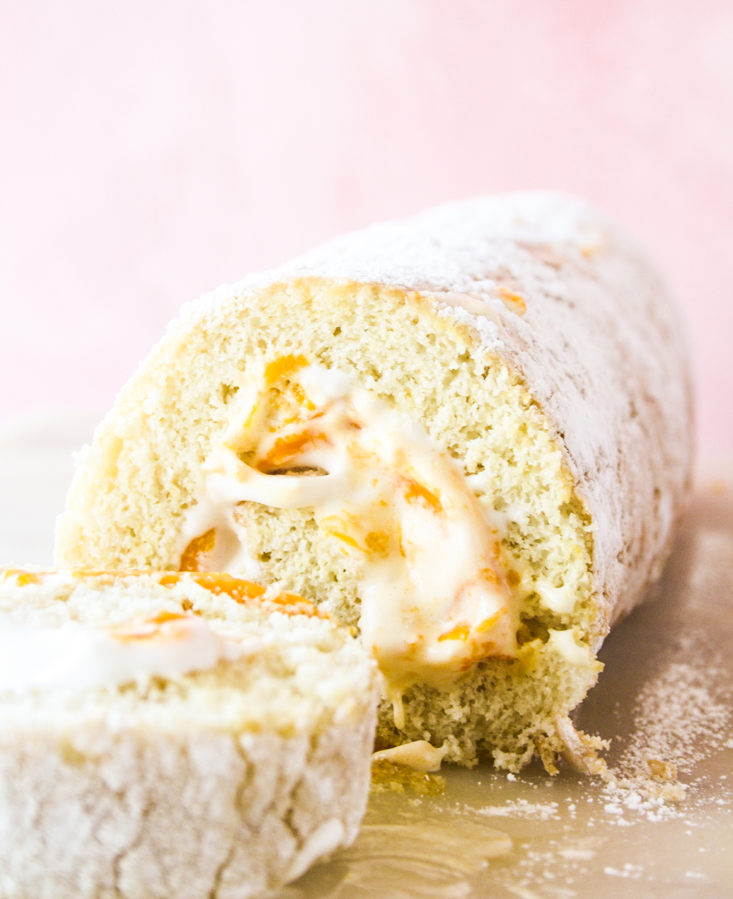 Light and fluffy roll cake with fresh mangoes and whipped cream